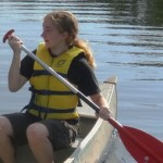 Girl canoeing at Kirkmont Center